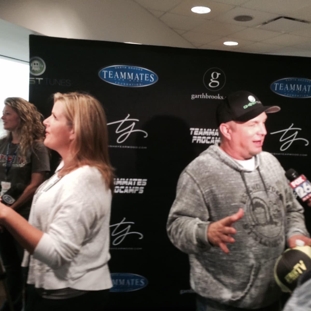 Garth Brooks and Trisha Yearwood at press conference at Toyota Center