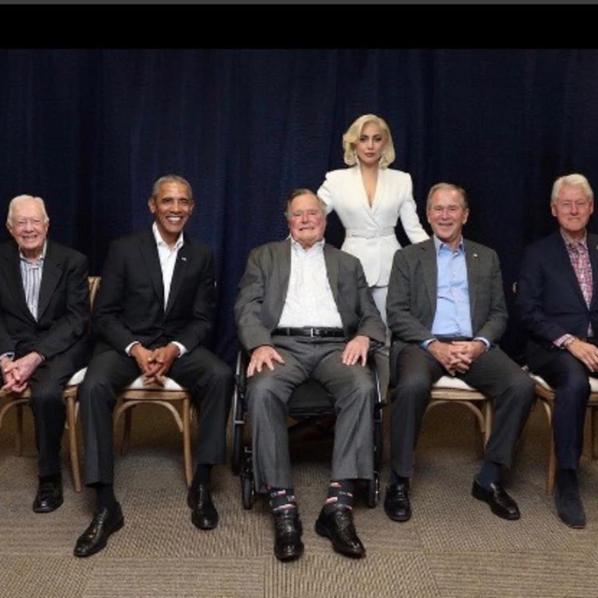 Lady Gaga poses with former presidents Jimmy Carter, Barack Obama, George HW Bush, George W Bush, and BIll Clinton at hurricane relief fundraiser