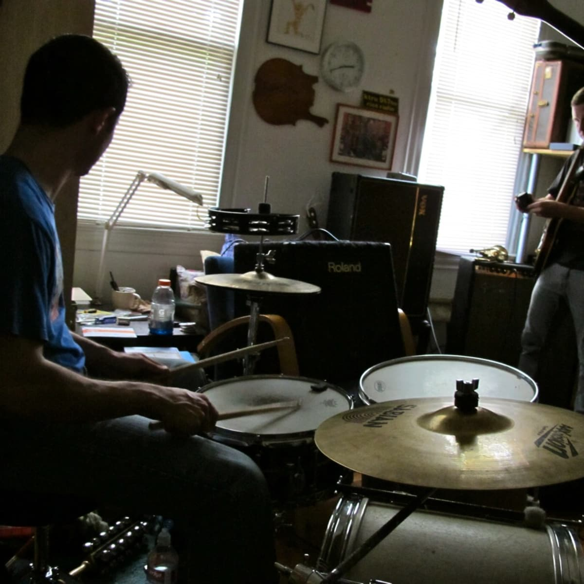 listenlisten in their din of dirges