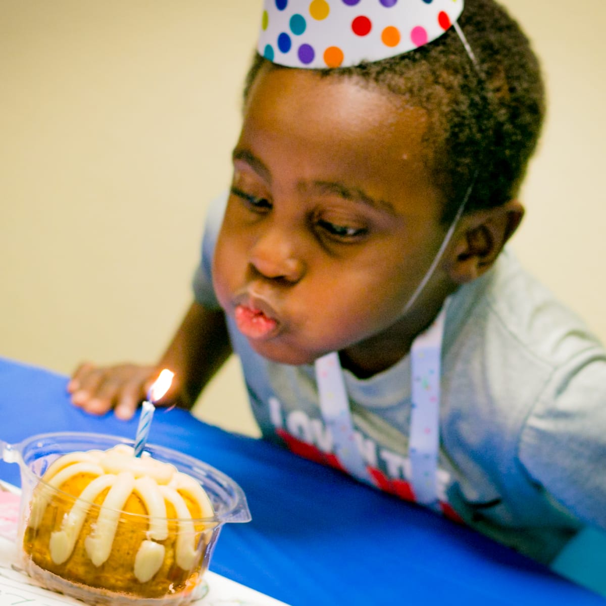 Boy blowing out candle courtesy of Dallas' Birthday Party Project