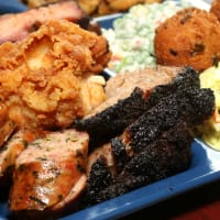 Plate of barbecue and sides at Slow Bone restaurant in Dallas