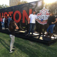 Super Bowl LIVE posing in front of Houston sign