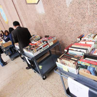 people shopping for books at Texas State Library and Archives Commission fundraiser