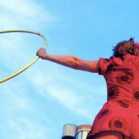 woman with hula hoops for Austin Review