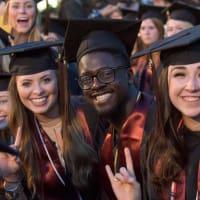 UT Austin university of texas commencement students hook em horns