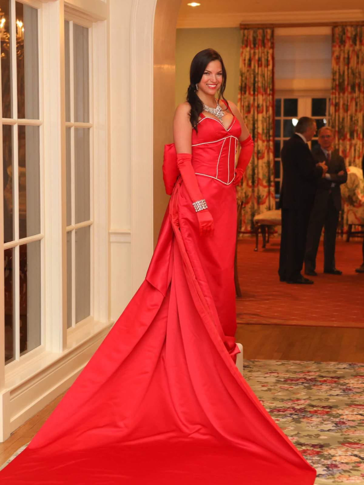 Model in gown at live red carpet at BARC gala