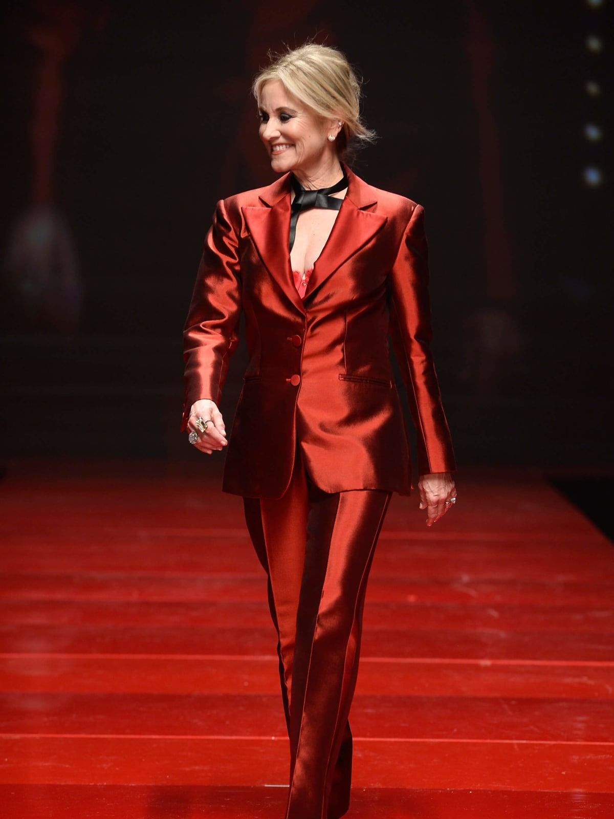 Actress Actress Maureen McCormick walks the runway at the American Heart Association's Go Red For Women Red Dress Collection 2017