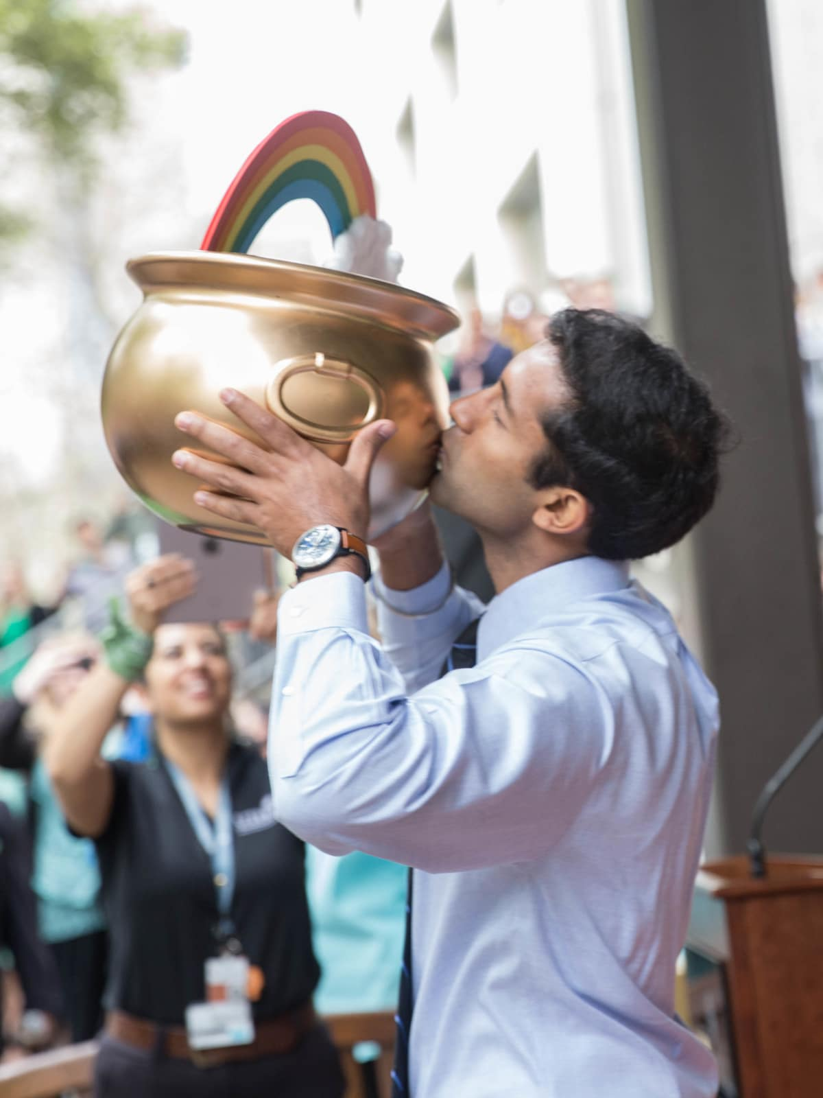 Students kisses the pot of gold at Match Day at UTHealth McGovern Medical School