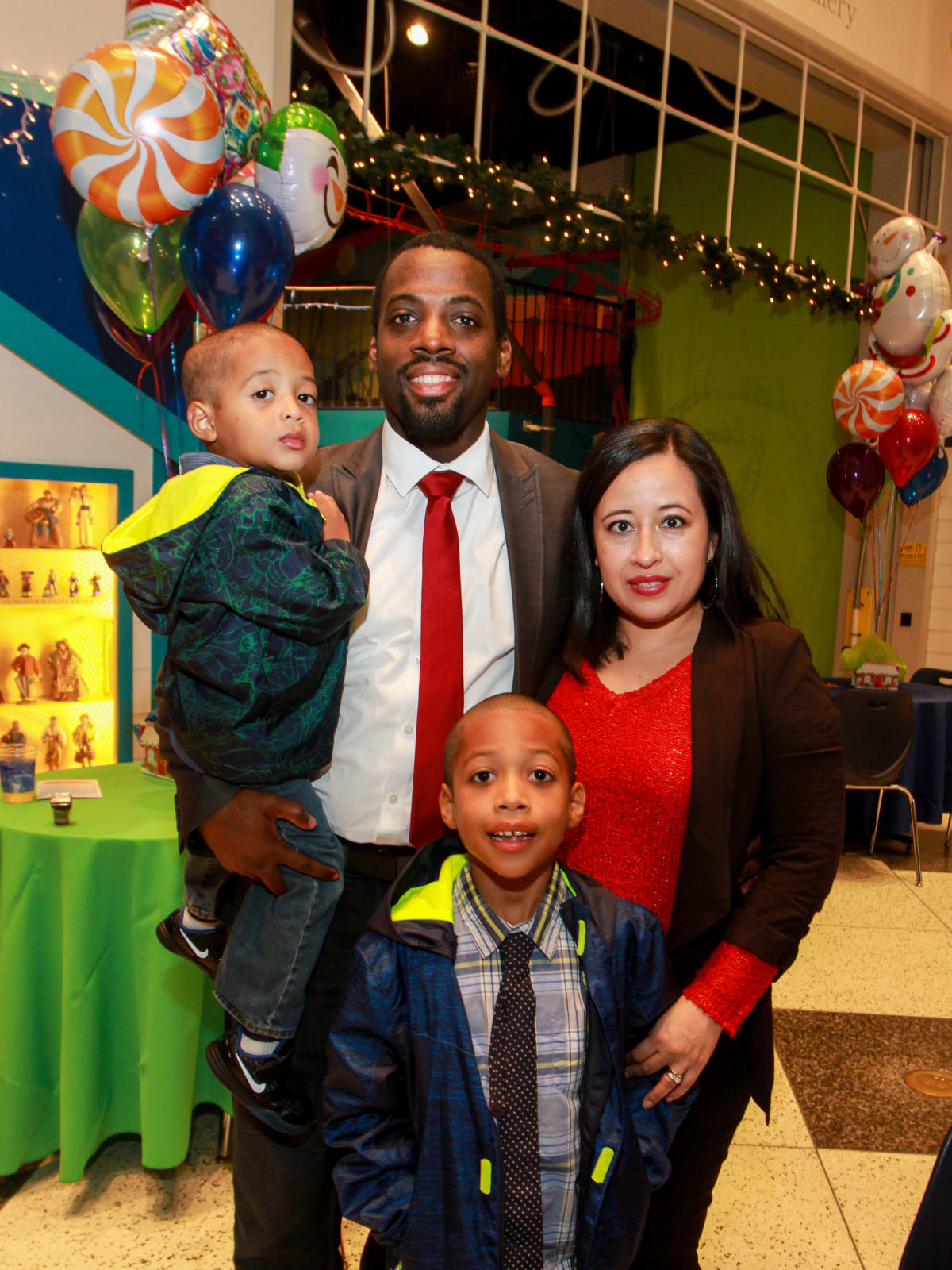 Children's Museum holiday party, Hakim Johnson, Araceli Johnson and children