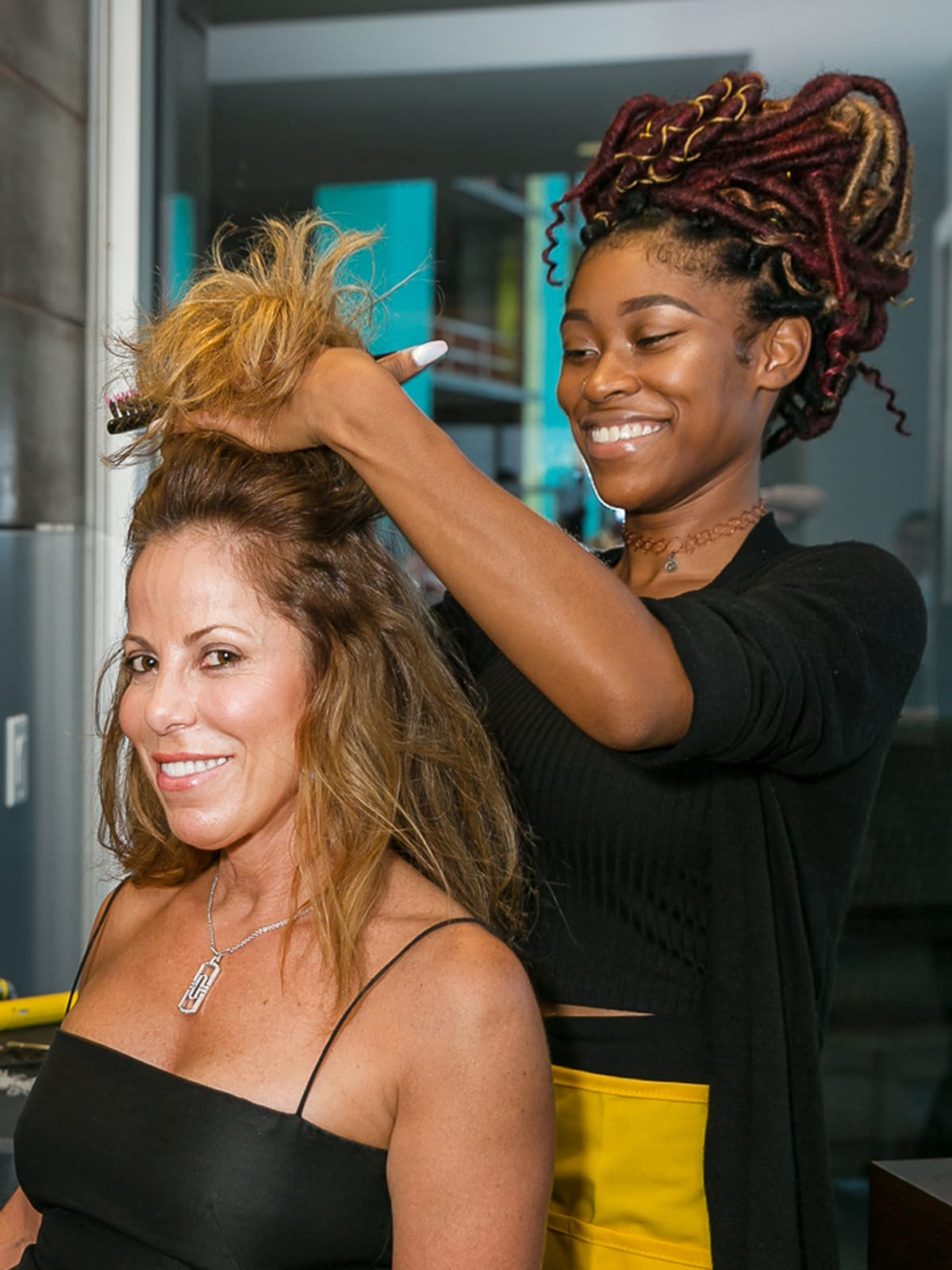 CultureMap Country Club Social, Christine Winston having hair done, Davijah Brown, Stylist Drybar