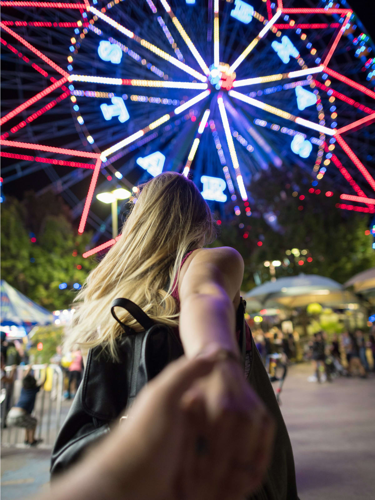 Woman about to ride the Texas Star ferris wheel