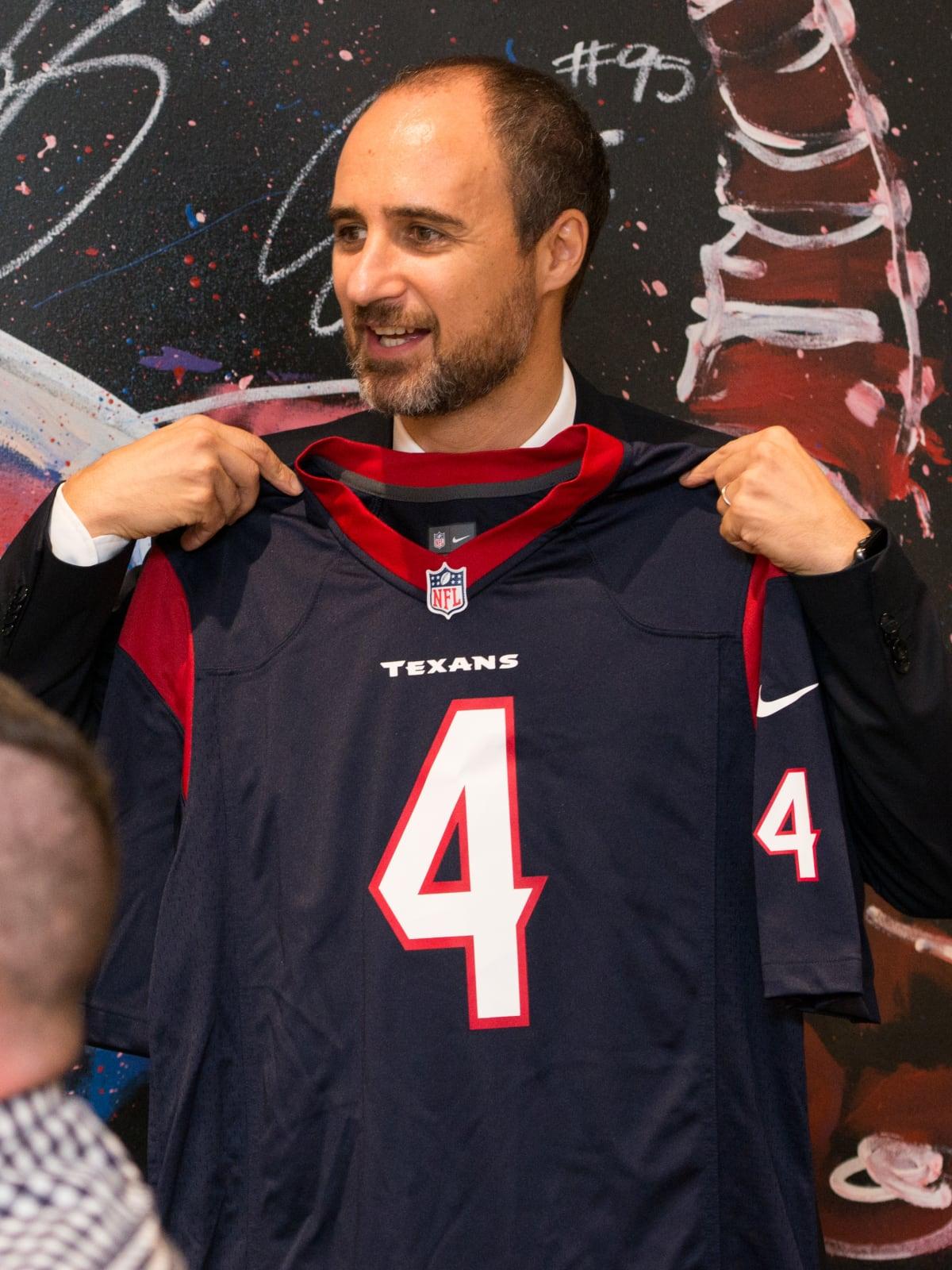 Jeweler Mattia Cielo and Texans jersey at IW Marks