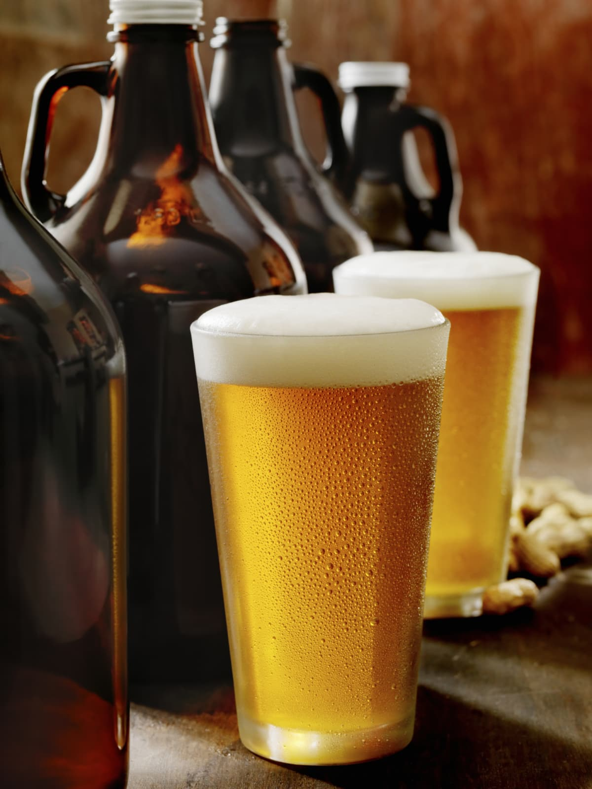 Glass of beer and growlers