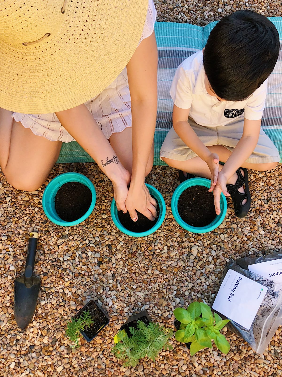 Mother and child gardening