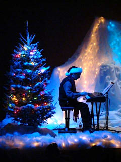Rich Harney playing piano for A Child's Christmas in Wales