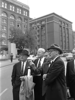 Warren Commission members and staff visit Dealey Plaza in 1964