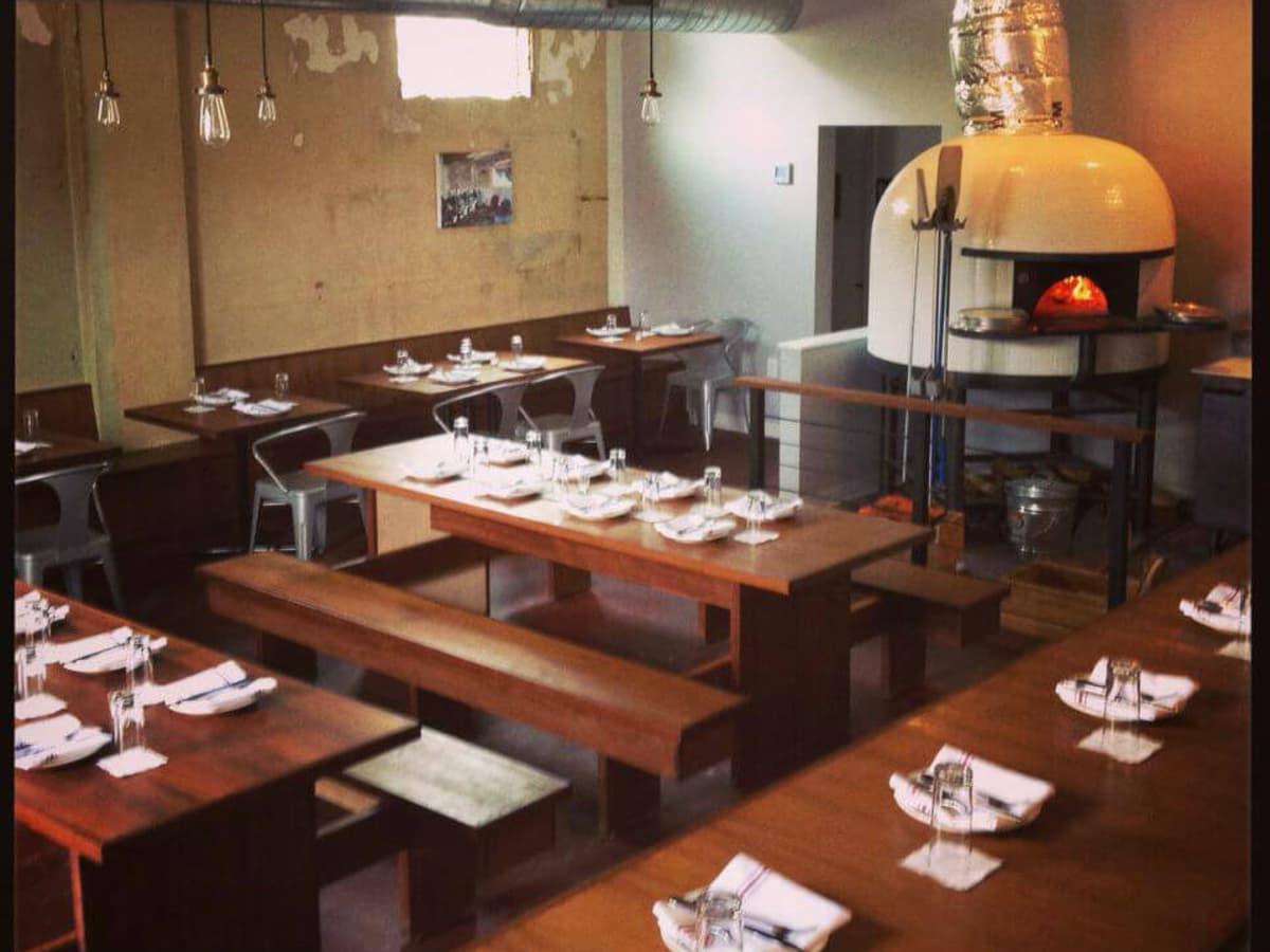 Bufalina pizza restaurant interior with brick oven