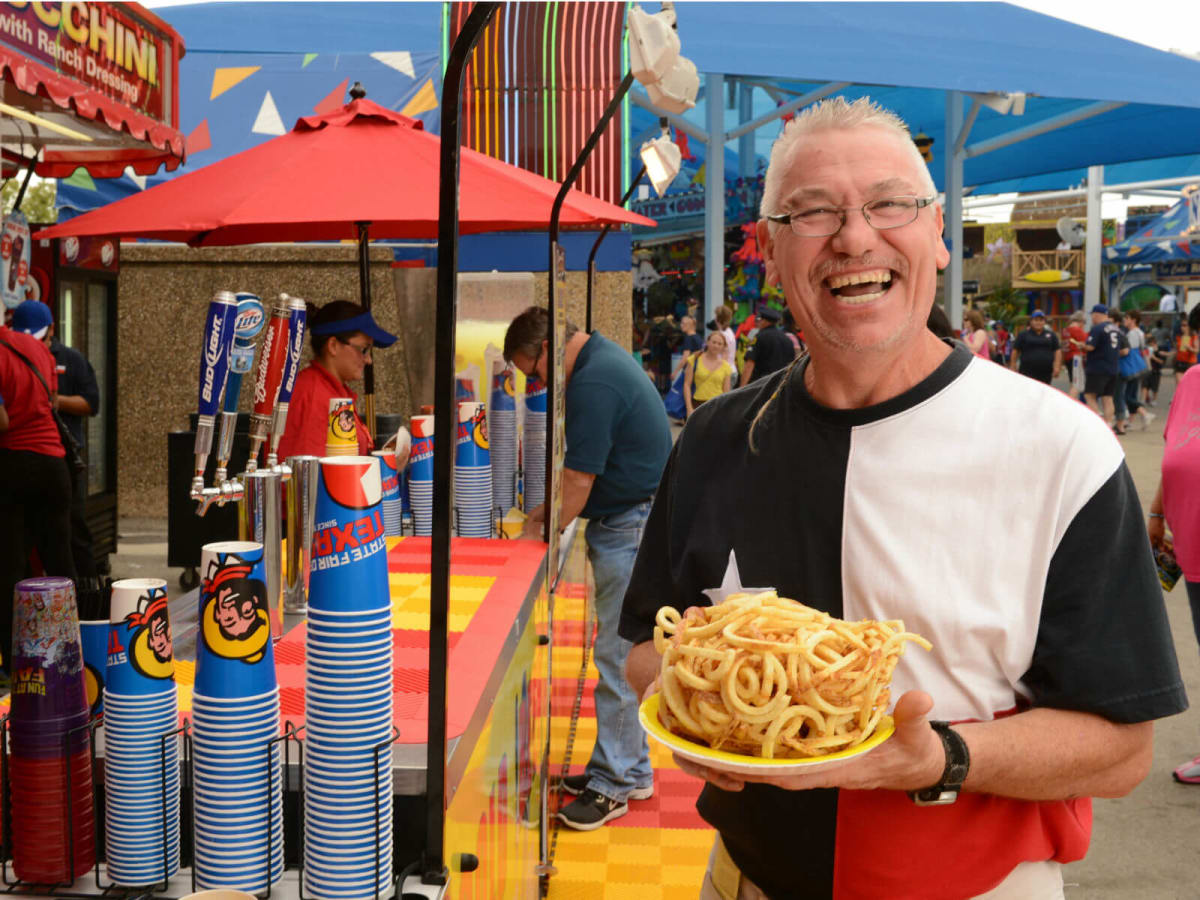 Man eating french fries at State Fair of Texas