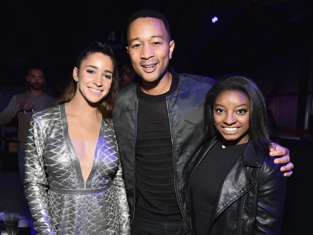 Aly Raisman, Simone Biles, and John Legend at Taylor Swift Club Nomadic concert