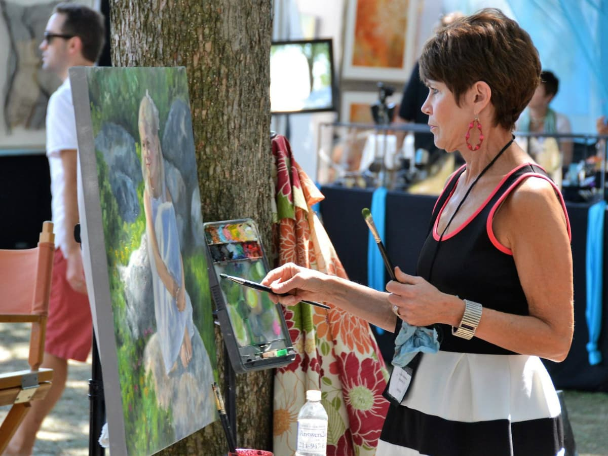 Woman painting at Cottonwood Art Festival 2016