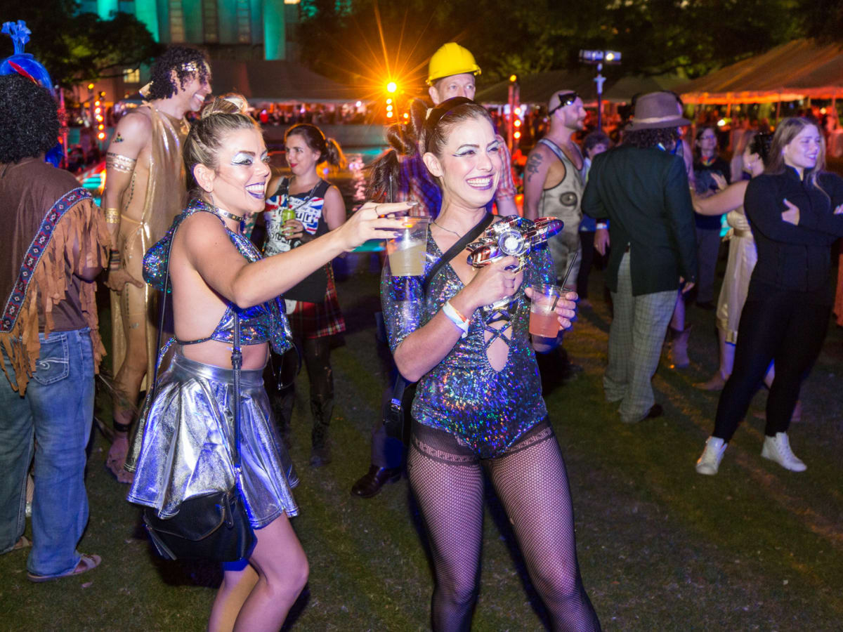 ) Partygoers danced to Calliope Musicals, who rocked the Legendary Art Car Ball stage