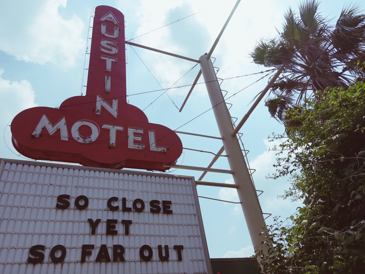 Austin Motel South Congress hotel Bunkhouse sign So Close Yet So Far Out