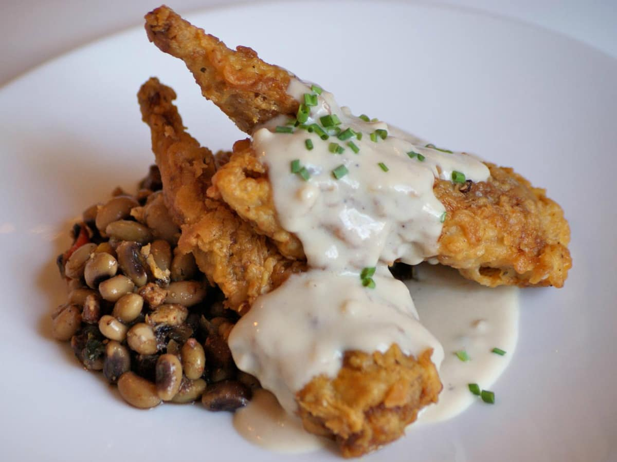 Hudson's on the Bend Austin resaurant Southern fried quail black eyed peas dish food