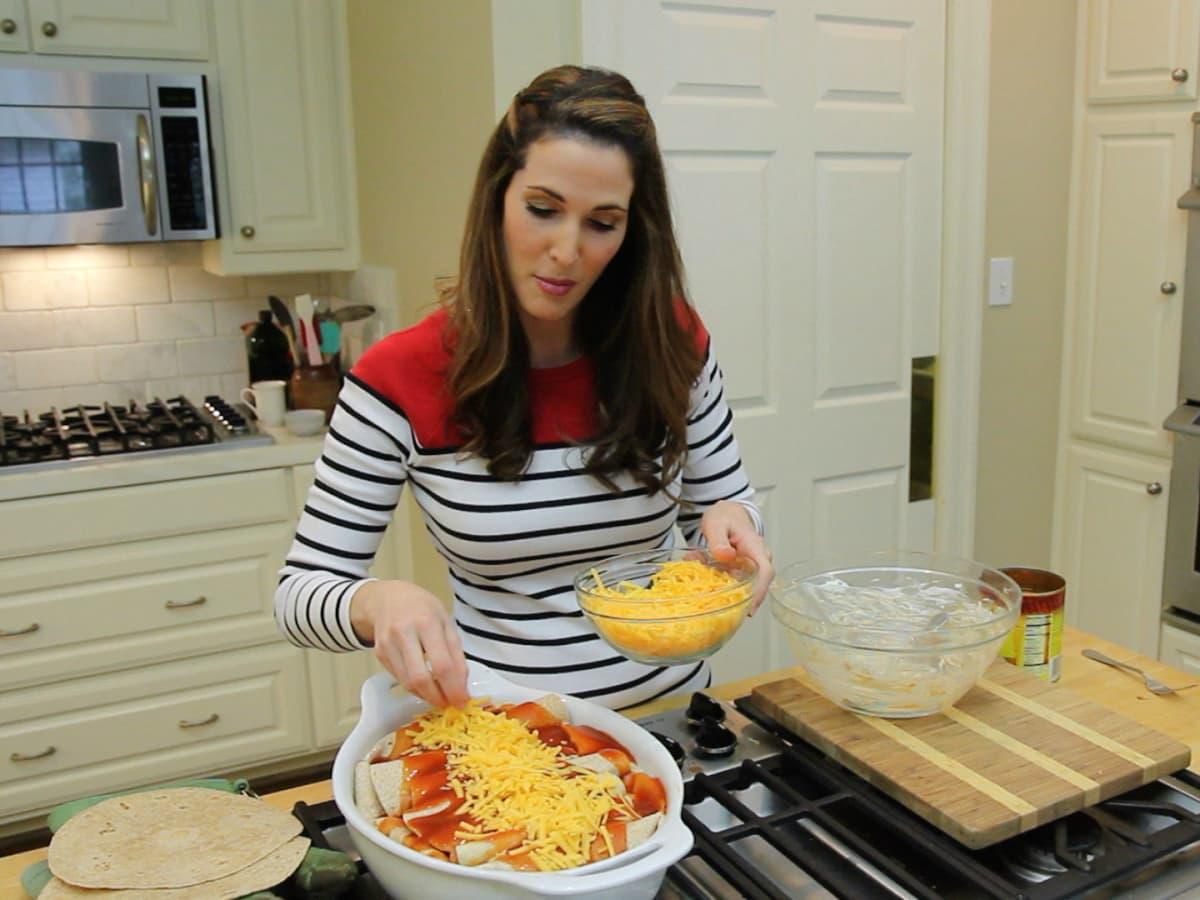 Roni Proter preparing enchiladas