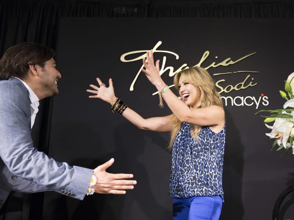 Thalia greets a fan at Macy's Memorial City store