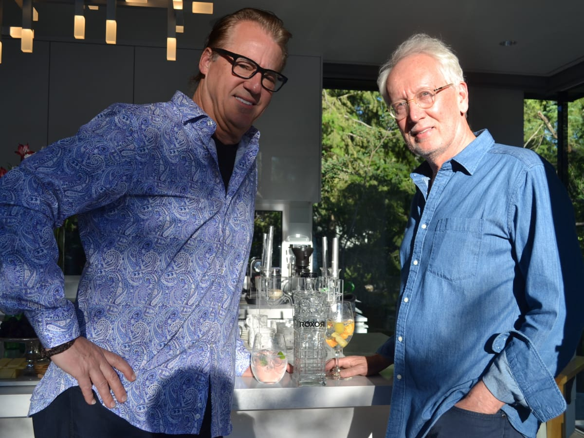 Robert Del Grande and Don Short with a bottle of Roxor Gin at Aspen Food & Wine festival