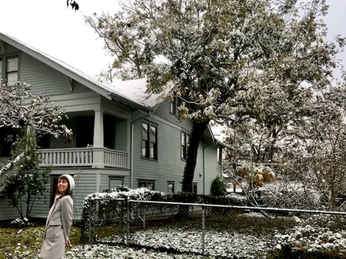 Woman in snowy Heights neighborhood