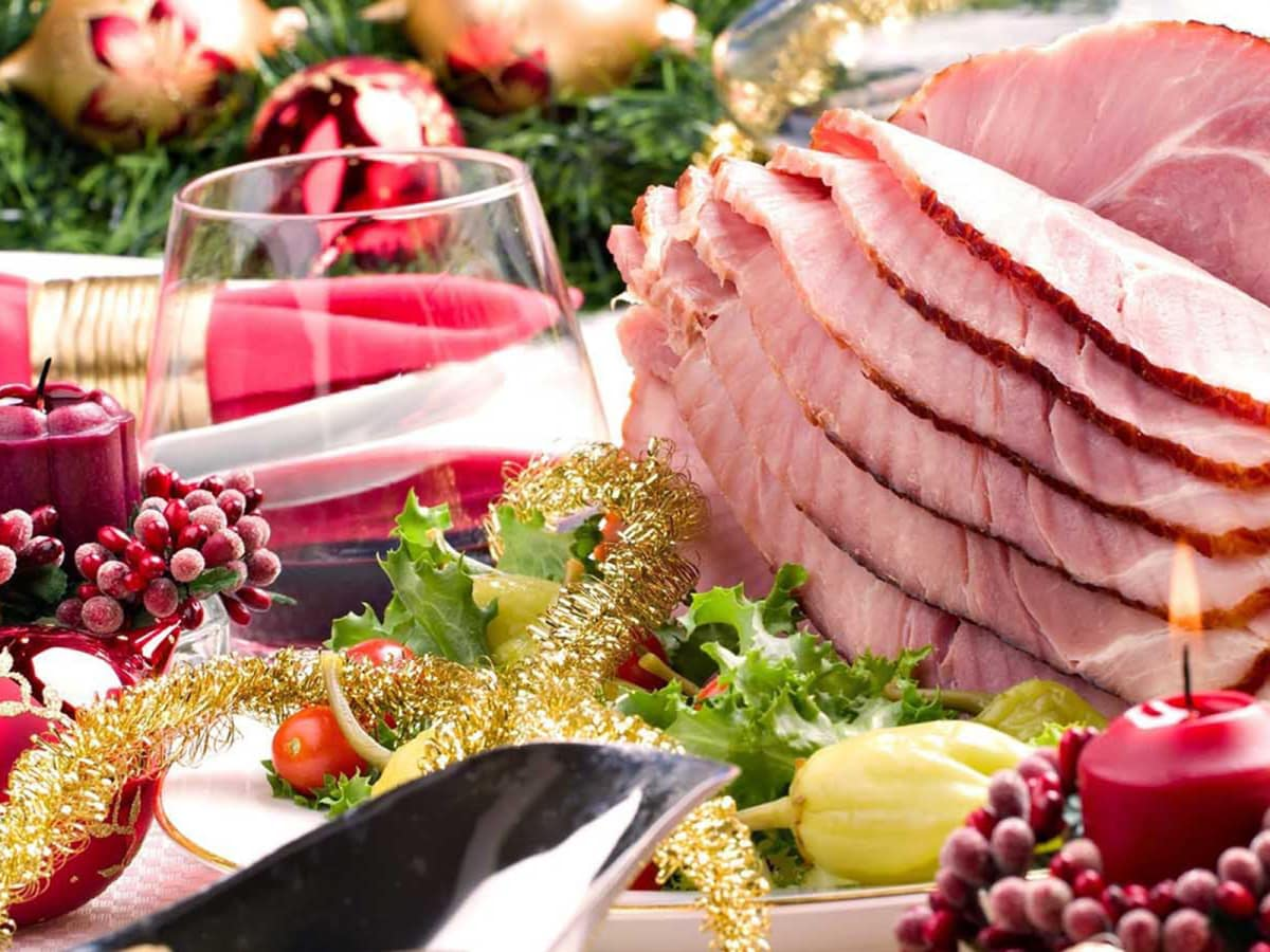 christmas dinner with ham and red wine and candles - Best Christmas Ham