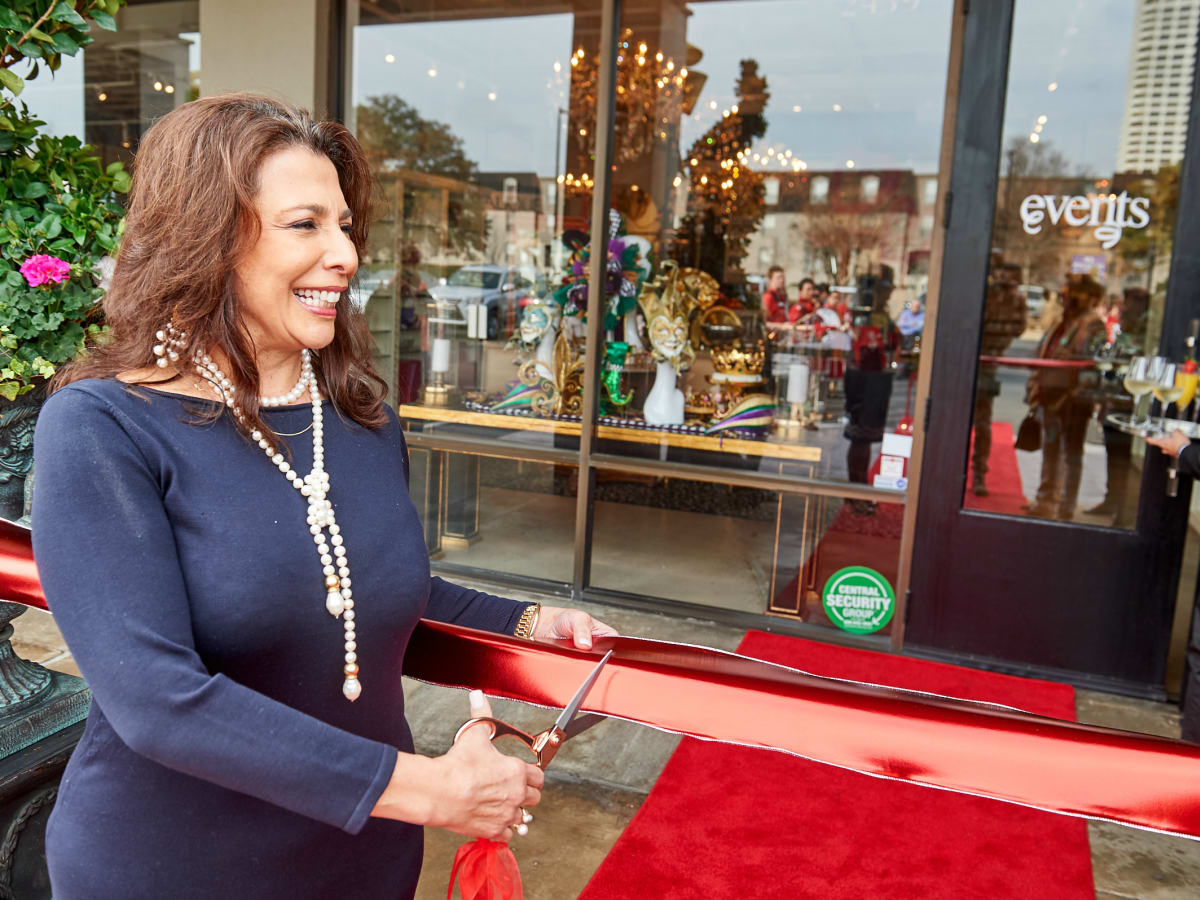 Events grand opening Regina Garcia owner cutting red ribbon