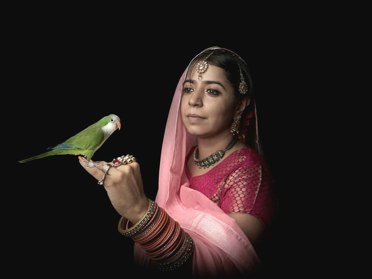 Fotofest women in sari with parrot