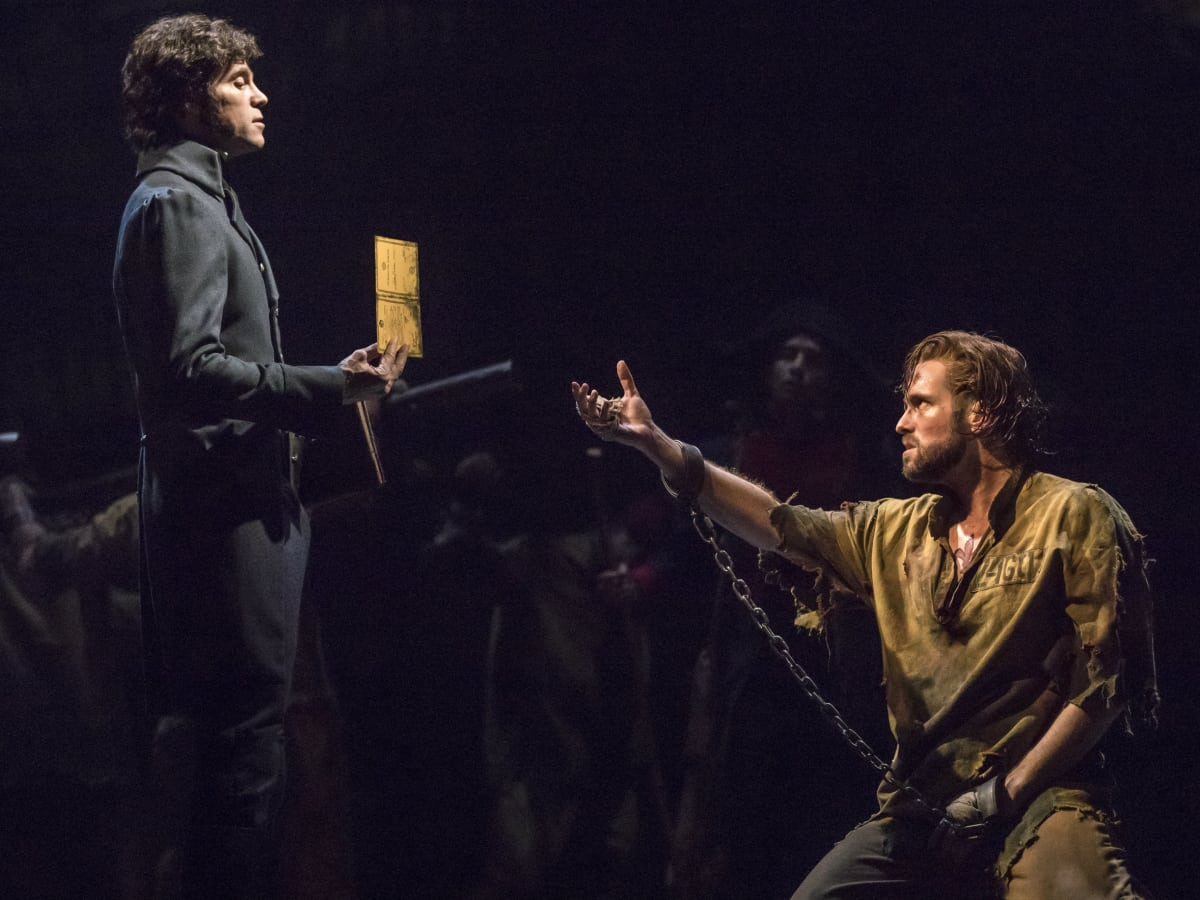 Josh Davis as Inspector Javert and Nick Cartell as Jean Valjean in the new national tour of Les Miserables