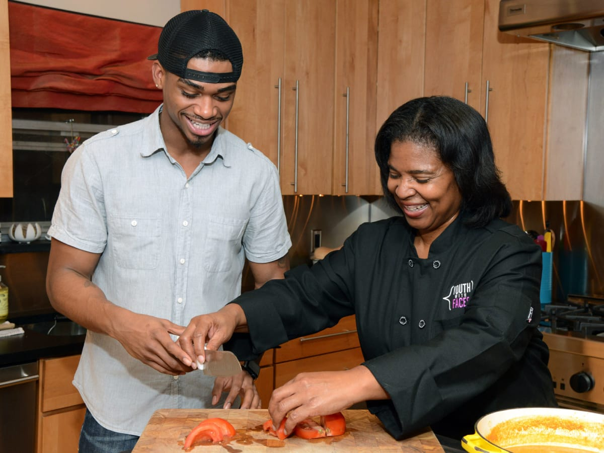 Youth With Faces graduate and Culinary Arts program director Terry Lynn Crenshaw cook together after his release