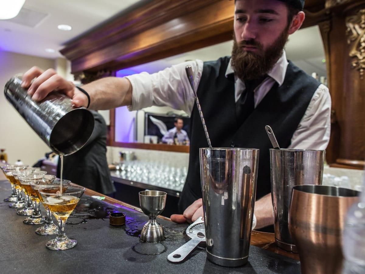 Houston Whiskey Festival bartender pouring