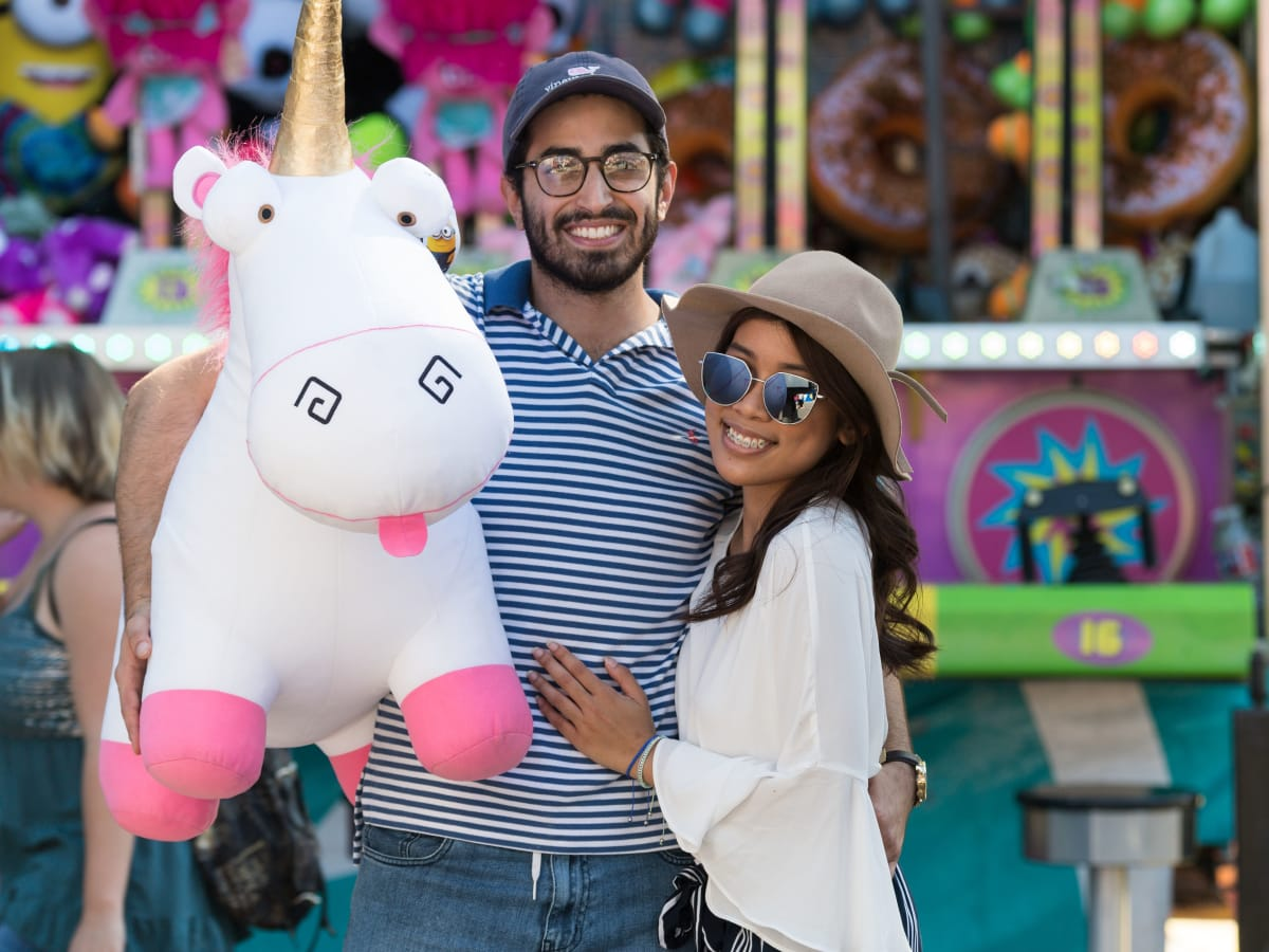 Couple holding a stuffed animal at the Midway