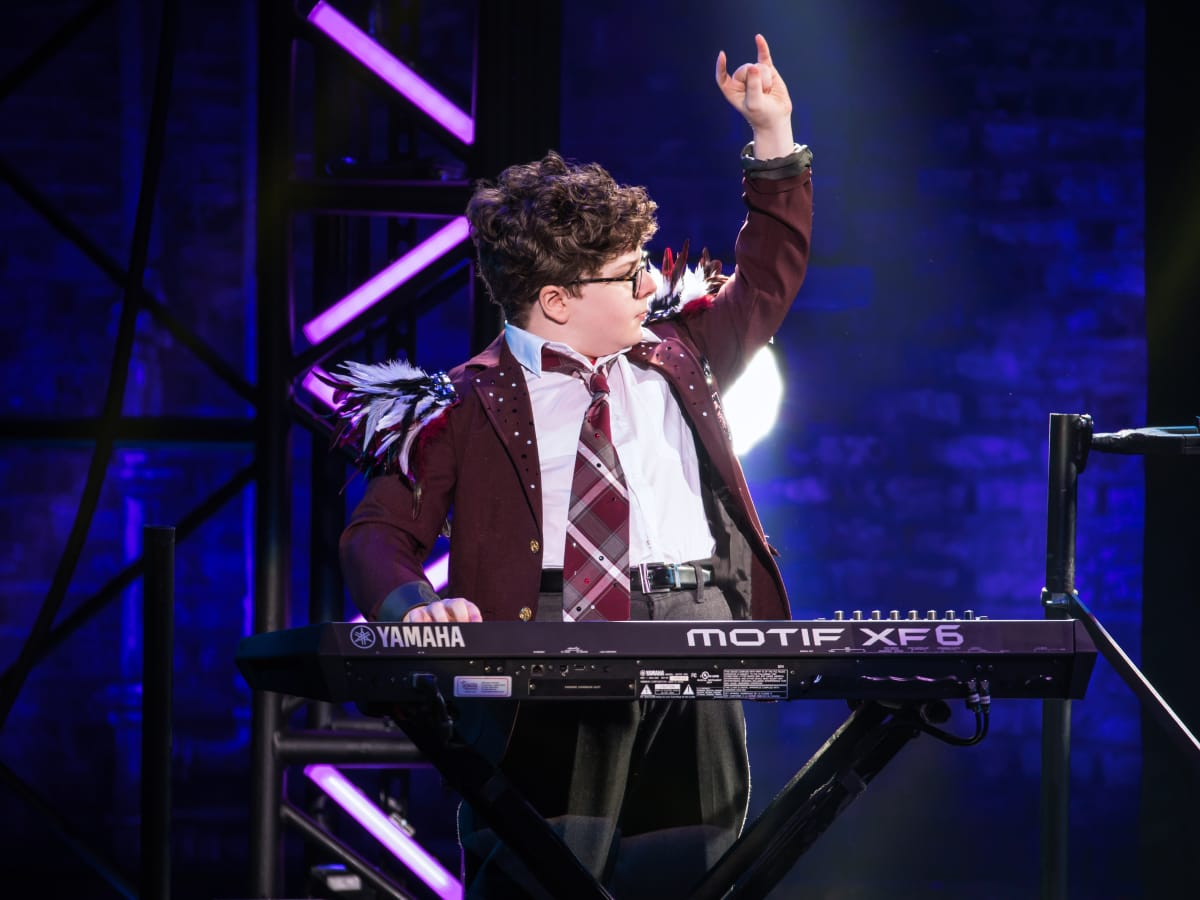 Theo Mitchell-Penner in the School of Rock Tour