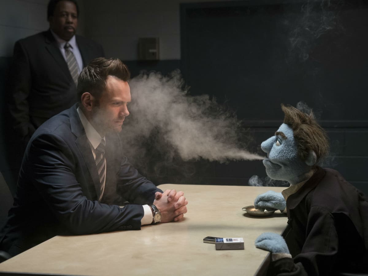 Joel McHale and Phil Phillips in The Happytime Murders