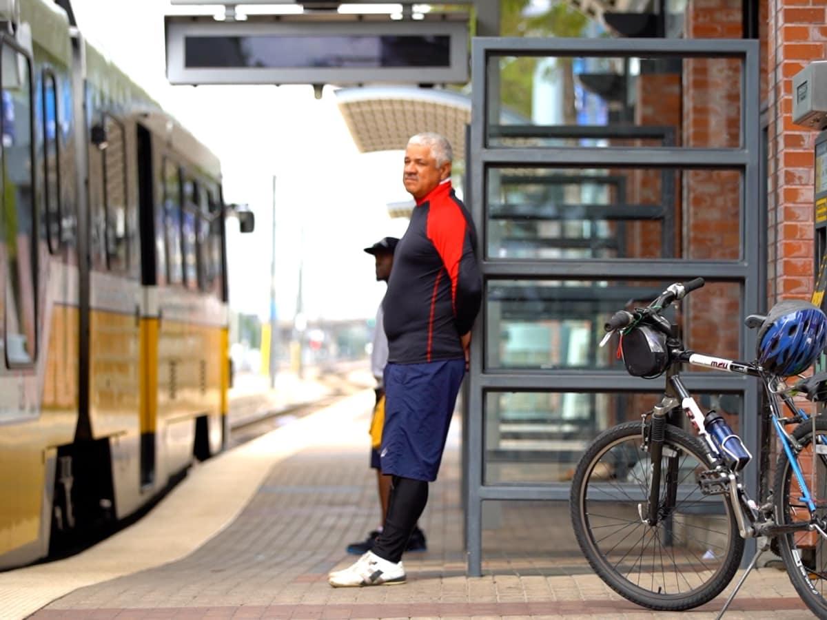 Man waits to board DART with his bike