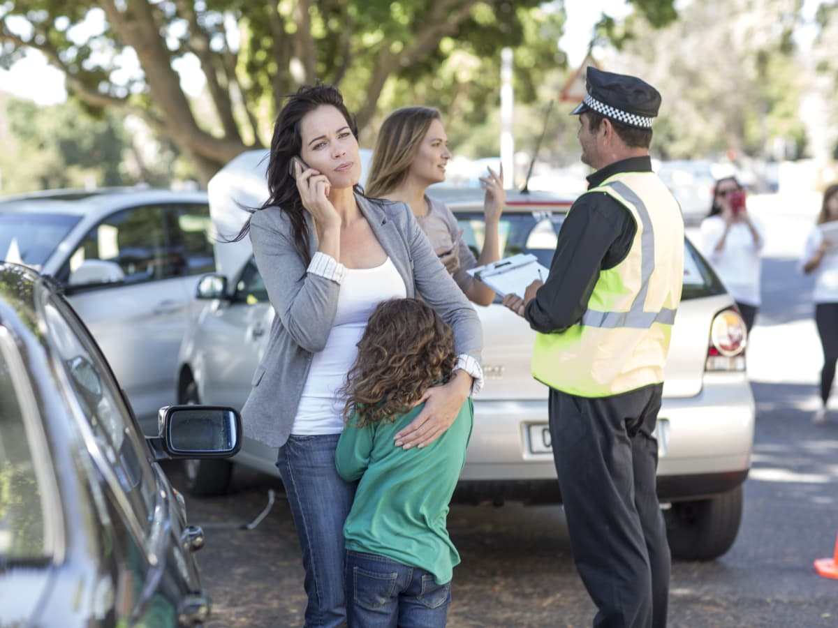 Woman and daughter after car accident