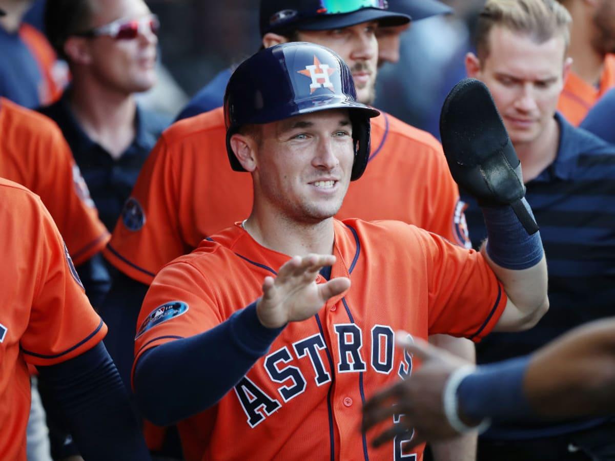 Alex Bregman high 5 five Astros orange jersey close up