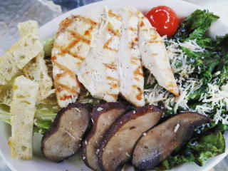 Grilled romaine salad with chicken and portobellos at Celebration restaurant in Dallas
