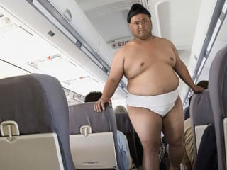 sumo wrestler, airplane, plane cabin