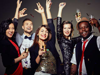 Men and women celebrating New Year's Eve
