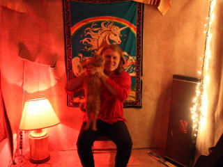 musician and songwriter Ty Segall holding a cat
