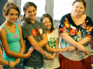 young girls and mentor at GENaustin We Are Girls Conference
