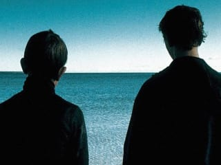 screen shot from Russian film The Return with two boys in silhouette
