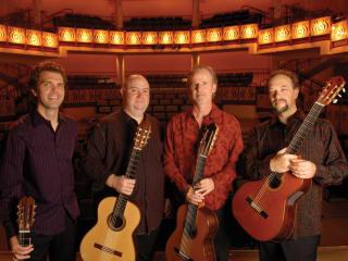 members of LA Guitar Quartet standing in a theater